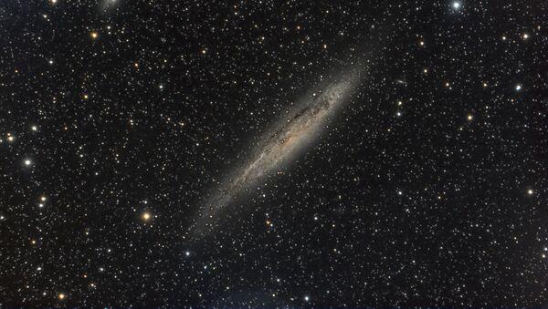 La galaxia NGC 4945 - Sputnik Mundo