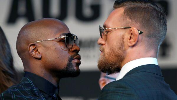 El luchador de MMA, Conor McGregor, y el boxeador Floyd Mayweather (archivo) - Sputnik Mundo