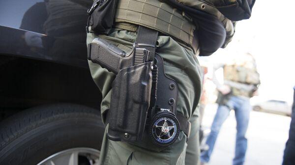 Policía armado de EEUU (imágen referencial) - Sputnik Mundo