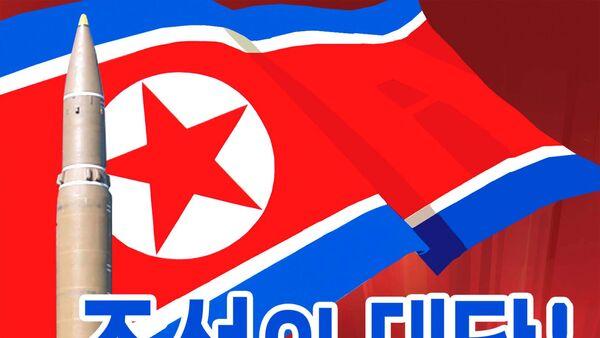 Una cartel propagandística con la bandera de Corea del Norte y el lanzamiento de un misil balístico hacia EEUU - Sputnik Mundo
