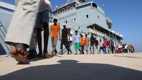 Migrantes libios (archivo) - Sputnik Mundo