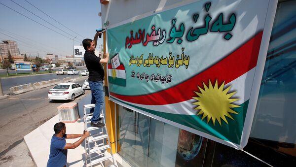 Los kurdos iraquíes ponen un cartel llamando a votar en el referéndum independista - Sputnik Mundo