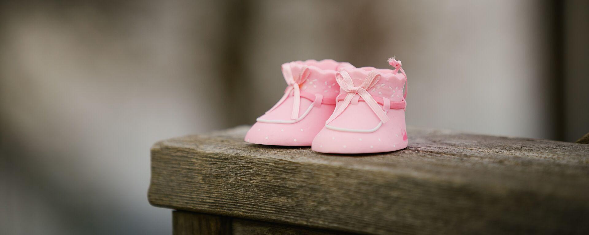 Zapatos de bebé (imagen referencial) - Sputnik Mundo, 1920, 05.09.2021