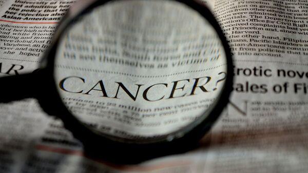 Un artículo sobre el cáncer (imagen referencial) - Sputnik Mundo