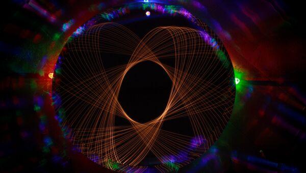 Un átomo de luz - Sputnik Mundo