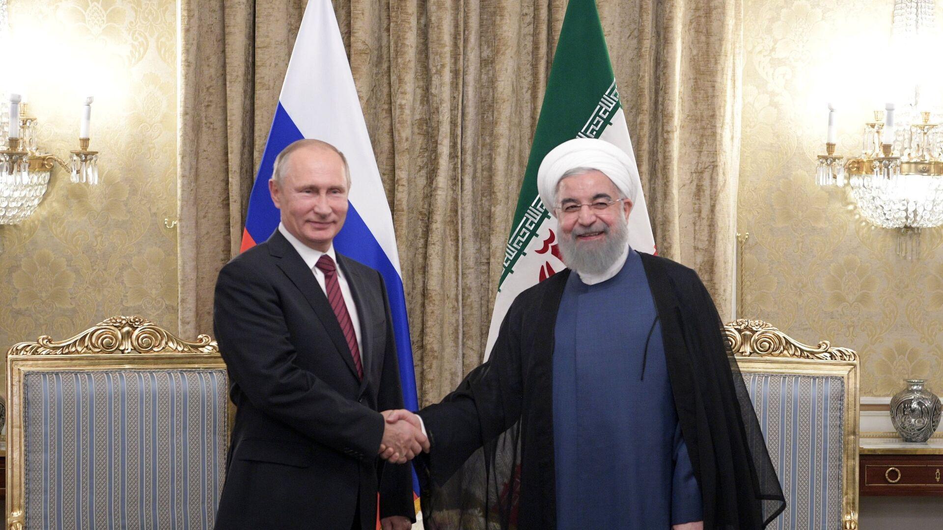 Presindente de Rusia, Vladímir Putin y presidente de Irán, Hasán Rohaní (archivo) - Sputnik Mundo, 1920, 12.03.2021