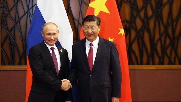 El presidente de Rusia, Vladímir Putin, y el presidente de China, Xi Jiping - Sputnik Mundo