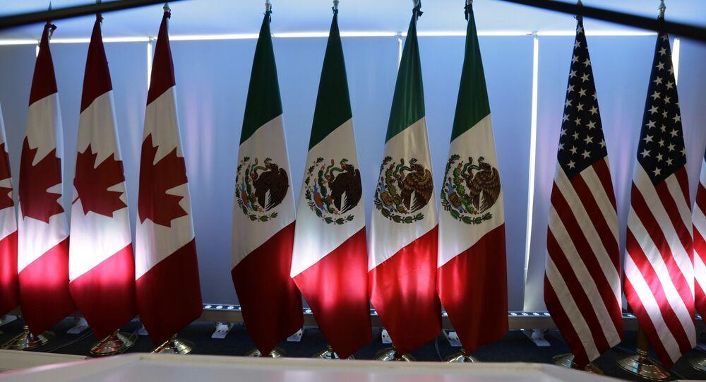 Las banderas de Canadá, México y EEUU, firmantes del TLCAN