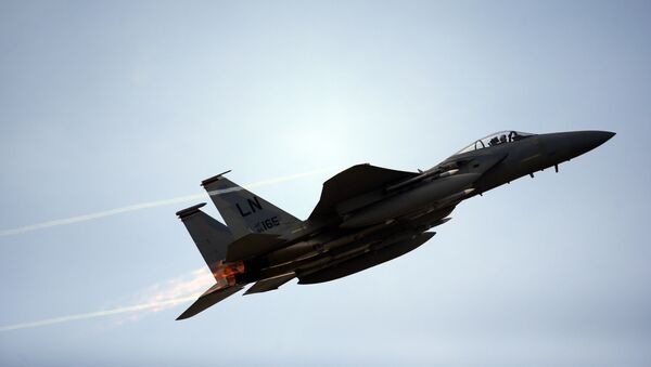 Un caza F-15C estadounidense (archivo) - Sputnik Mundo