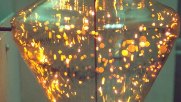 Gotas flotantes de combustible de agua y carbón en la cámara de combustión - Sputnik Mundo