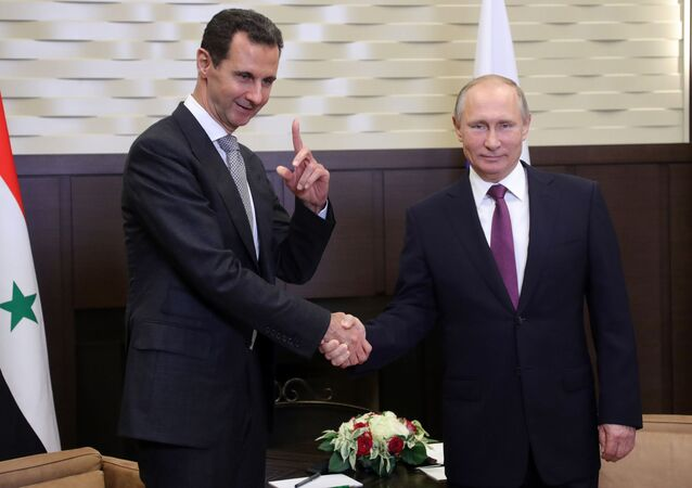 Vladímir Putin, presidente de Rusia, y su homólogo sirio, Bashar Asad