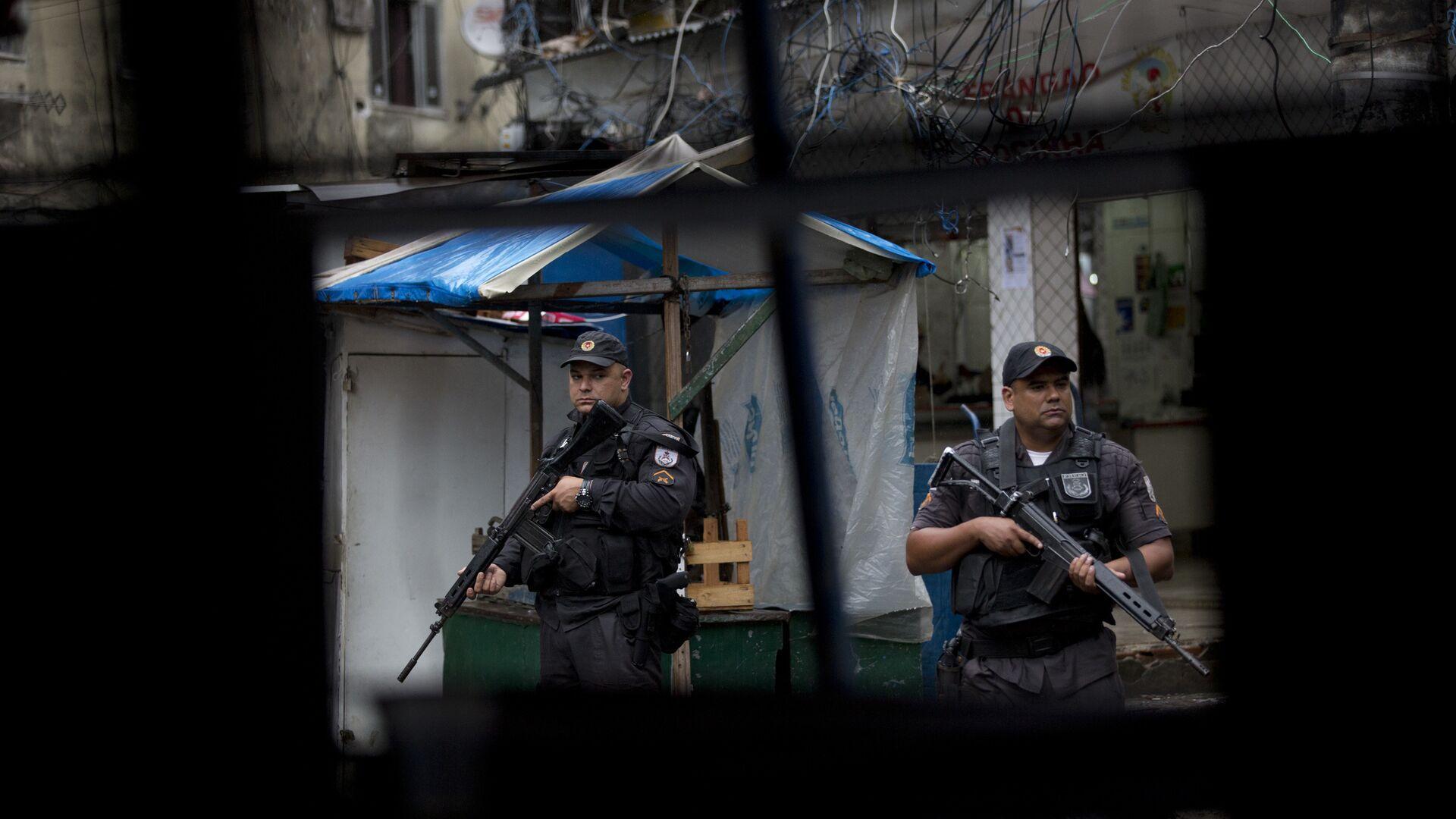 Policía militar brasileña en la favela Rocinha de Río de Janeiro - Sputnik Mundo, 1920, 18.06.2021