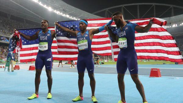 Miembros del equipo de EEUU, Justin Gatlin, Mike Rodgers y Tyson Gay en los JJOO 2016 de Río de Janeiro - Sputnik Mundo
