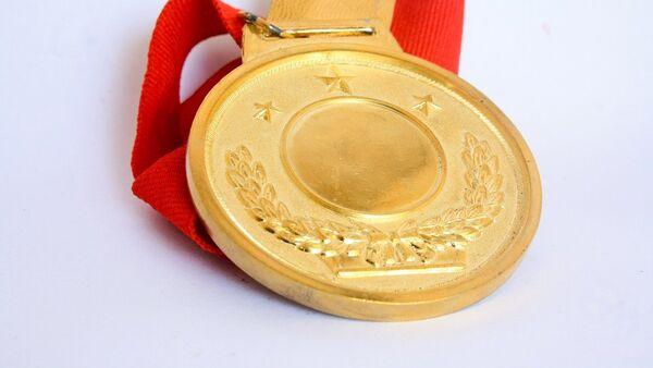 Una medalla de oro, imagen referencial - Sputnik Mundo