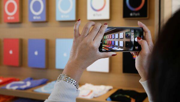 Un iPhone X - Sputnik Mundo