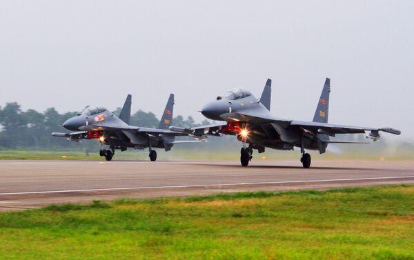 Cazas Su-30 de la Fuerza Aérea de China.  - Sputnik Mundo