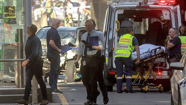 Policía australiana en el lugar del atropello en Melbourne - Sputnik Mundo