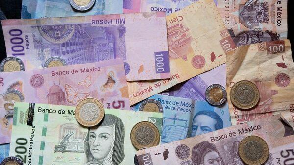 Pesos mexicanos (imagen referencial) - Sputnik Mundo