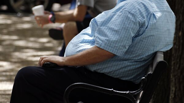 Una persona con sobrepeso (imagen referencial) - Sputnik Mundo