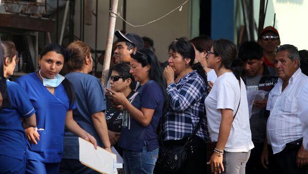 Familiares de las víctimas del accidente con autobús en Perú - Sputnik Mundo