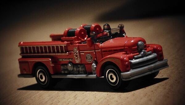 Un modelo de camión de bomberos (imagen referencial) - Sputnik Mundo