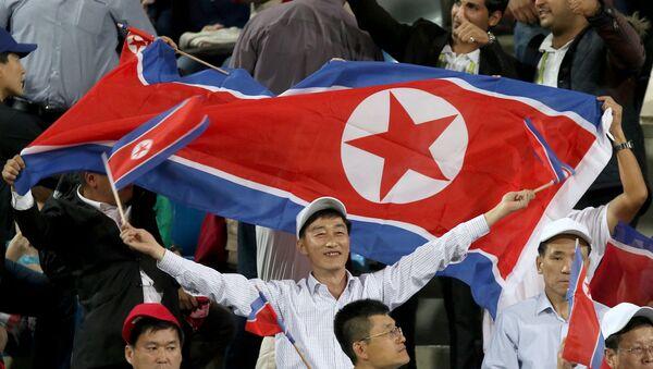 Hinchas norcoreanos (archivo) - Sputnik Mundo