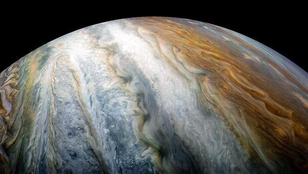 Planeta Júpiter captado por la sonda Juno (archivo) - Sputnik Mundo