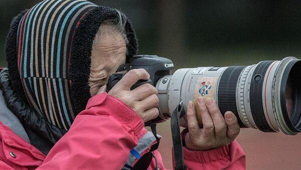 La veterana fotógrafa china Hong Nanli - Sputnik Mundo