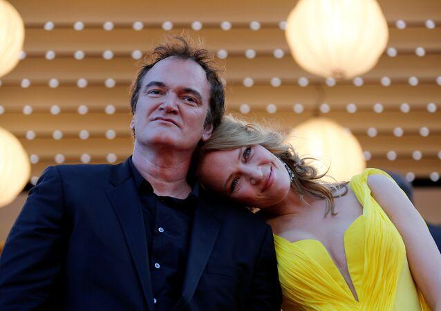 Quentin Tarantino, director del cine, y Uma Thurman, actriz