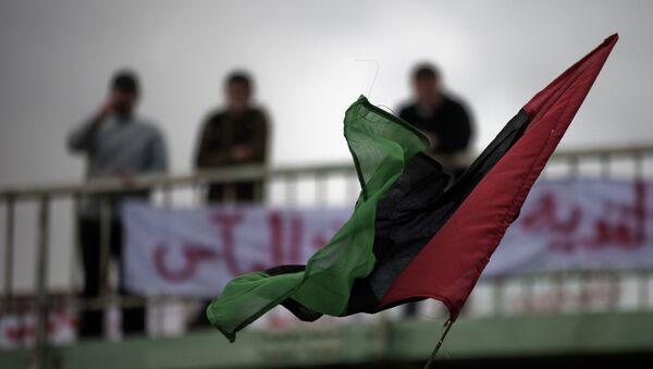 Bandera de Libia en la ciudad de Derna (archivo) - Sputnik Mundo