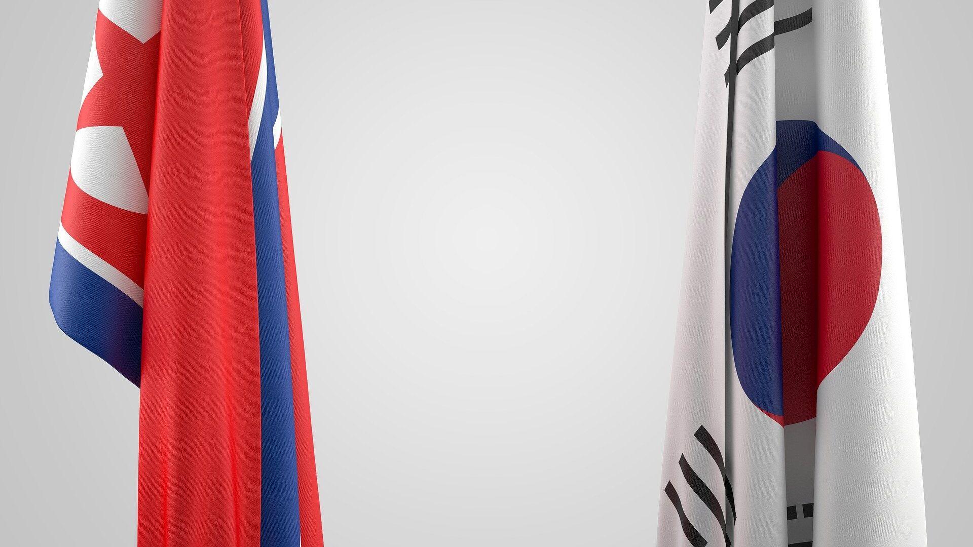 Las banderas de Corea del Norte y Corea del Sur - Sputnik Mundo, 1920, 30.07.2021