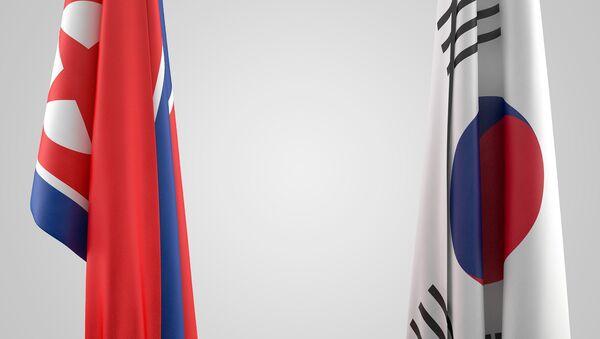Las banderas de Corea del Norte y Corea del Sur - Sputnik Mundo