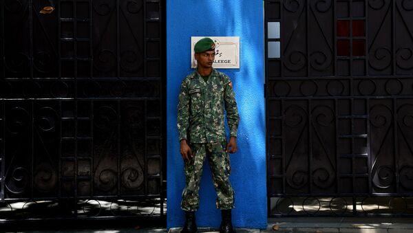 Un soldado de la Maldivas - Sputnik Mundo