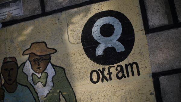Logo de Oxfam - Sputnik Mundo
