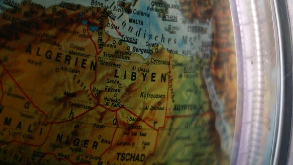 Un mapa de Libia en un globo (imagen referencial) - Sputnik Mundo