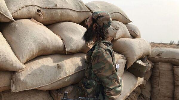 Un miliciano sirio (archivo) - Sputnik Mundo