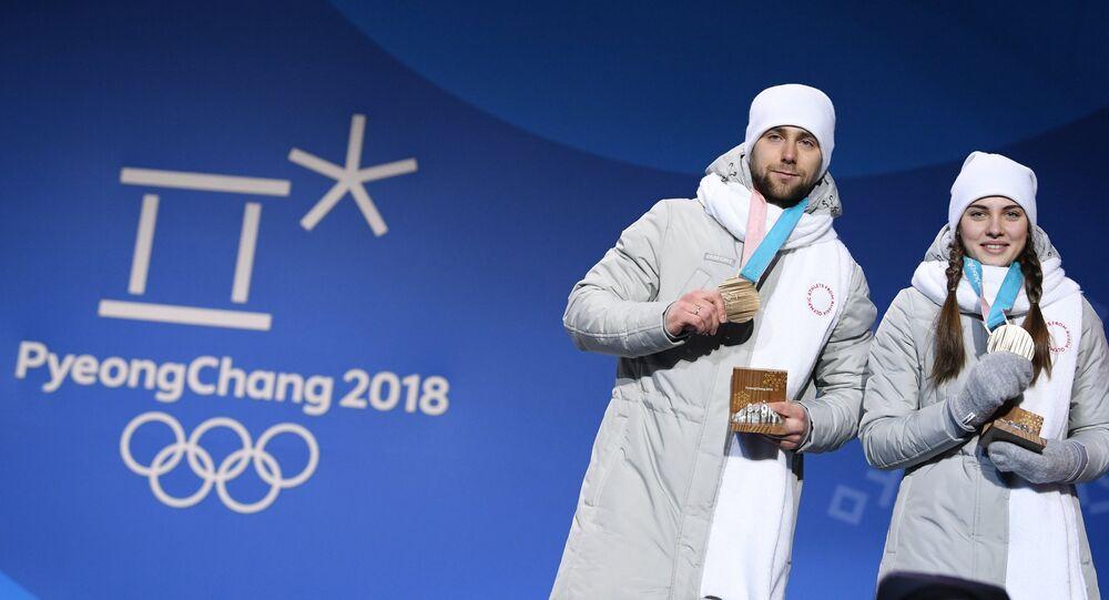Alexandr Krushelitski y Anastasía Brizgálova, jugadores de curling rusos