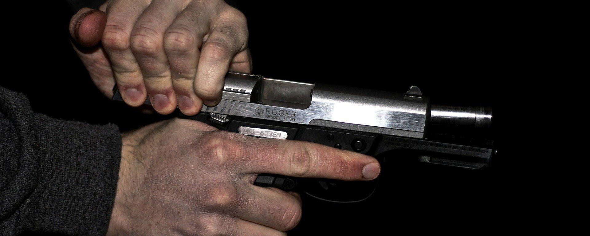 Una pistola (imagen referencial) - Sputnik Mundo, 1920, 13.06.2021