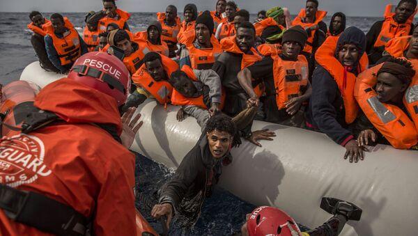 Migrantes de Libia - Sputnik Mundo