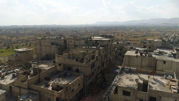 Un corredor humanitario entre Damasco y Guta Oriental en la zona del campo para los refugiados Wafidin - Sputnik Mundo