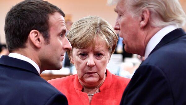 Los presidentes Emmanuel Macron, de Francia, y Donald Trump, de EEUU, y la canciller (jefa de Gobierno) de Alemania, Angela Merkel - Sputnik Mundo