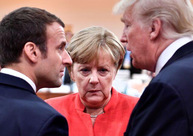 El presidente de Francia, Emmanuel Macron; la canciller alemana, Angela Merkel, y el presidente de EEUU, Donald Trump