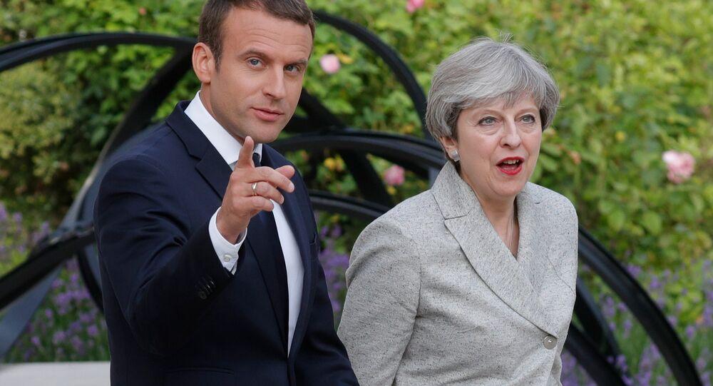 Presidente de Francia, Emmanuel Macron, y primera ministra del Reino Unido, Theresa May