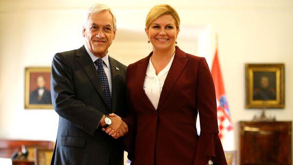 El presidente de Chile, Sebastián Piñera, junto a la presidenta de Croacia, Kolinda Grabar-Kitarović - Sputnik Mundo
