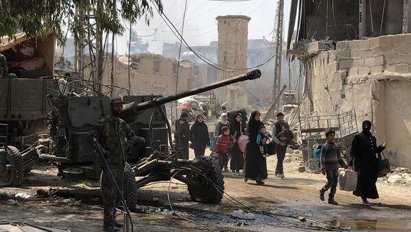 Civiles abandonaron Guta Oriental, el suburbio de Damasco, la capital de Siria - Sputnik Mundo