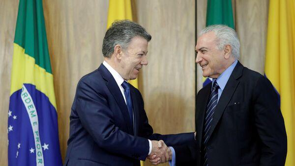El presidente de Colombia, Juan Manuel Santos con su homólogo brasileño, Michel Temer - Sputnik Mundo