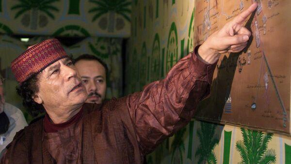Muamar Gadafi, expresidente de Libia - Sputnik Mundo