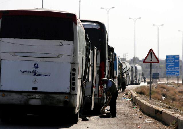 Evacuación en la ciudad siria de Duma