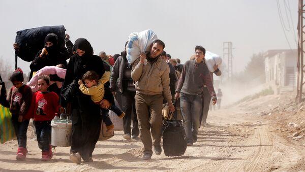 La evacuación de los civiles de Guta Oriental, Siria - Sputnik Mundo