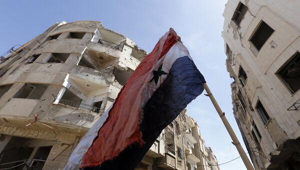 La bandera de Siria en Guta Oriental - Sputnik Mundo